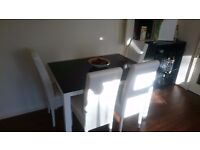 White table with cristal top and 4 white chairs to match (price negotiable)