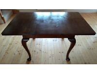 Elegant dining table dark wood