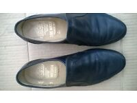 Mens size seven Grenson's navy moccasins.