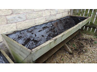 Two wooden garden planting trugs