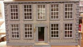 Vintage dolls house with lights and fireplaces
