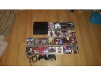 PS3 Slim with Games and 2 controllers