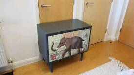 Chest of drawers with elephant and map travel motif