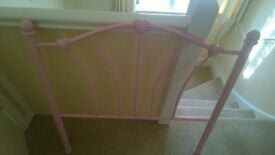 pink metal single bed frame with heart details