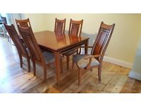 High quality, extendable, wooden dining table and 10 chairs