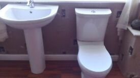 white toilet and sink very good condition the sink will need a new plug