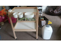 Changing table with racks and castor wheels + disposal tub