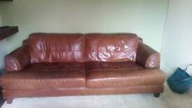 Brown leathers three seat settee