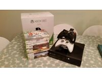 Xbox 360, 14 games, 2 controllers and battery charger.