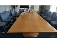 Large meeting room table and chairs