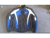 Motorcycle jacket, blue RST, size small.