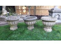 Three identical urn planters