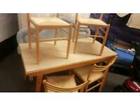 Table with 4 chairs in excellent condition