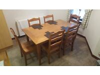 Solid oak table and chairs with veneer