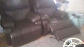 2 leather electronic operated armchairs in mint condition practically brand new