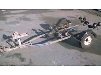 jet ski trailer,boat trailer,dinghy,small boat,boat,trailer,roller caoster,launching,trolly