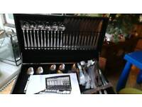 Brand new complete cutlery and serving set in box