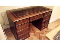 Pedestal Desk, dark oak-like wood, burgundy inlaid leather with gold trim top