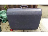 Large blue hard shell suitcase with number lock