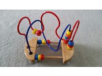 Wooden maze beads with suction cups