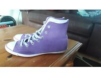 Purple suede high top converse.