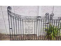 Pair of wrought iron driveway black gates