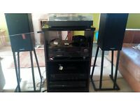 Stereo system - amplifier, cd player, tape deck and record player, speaker stands and speakers