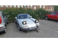 Silver MX 5 , in reasonable condition . Mileage in kilometers