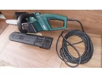Nearly New Electric Chain Saw with spare chain.