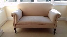 Late Victorian cream drop down sofa (circa 1888) .