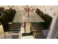 Dinning table and black leather chairs