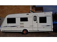 Compass Omega 505, 5 berth touring caravan, 2007. Front L shaped lounge and rear dining area