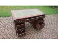 A traditional leather top pedestal desk
