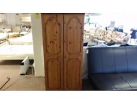 GOOD CONDITION 2 door pine wardrobe good condition with built in rail