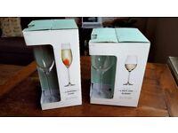 4 white wine glasses & 4 champagne flutes - still in the box - £17