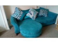 Four seater sofa and a two seater swivel chair