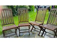 Four folding wooden garden chairs