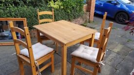 Pine table and 4 chairs lovely cond not even 12 months old.