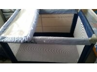 Blue travel cot for sale in great condition