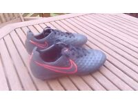 Nike size 4 Magista black and red football boots.