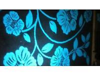 Floral rug aqua and black