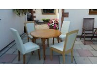 Round table and 4 cream chairs for sale - Good condition