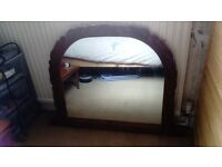 For sale oak mirror and oak fire surround. Both matching. In good condition