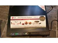 lg dvd receiver system 850w + free satellite receiver.