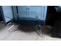 BLACK GLASS AND CHROME MODERN OVAL COFFEE TABLE
