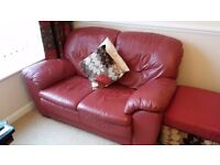 Two matching red leather sofas / settees