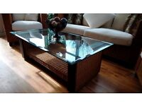 Furniture set comprises of 3 seater sofa, 2 chairs and glass top table with shelf.