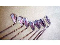 Wilson Staff irons..plus Jack Nicklaus golf bag with folding stand