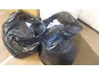 Lots of clothing for recycling.