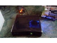 Black xbox 360 slim 250gb with blue led lights round fan